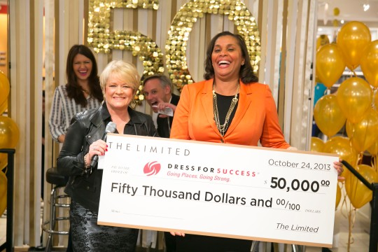 Joi Gordon (right) accepting the $50,000 check from The Limited